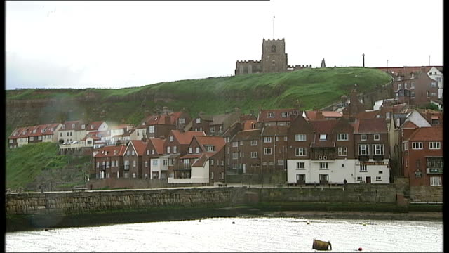 whitby fishing industry and general views good shot of whitby including whitby abbey seen on hillside above trawler 'rebecca elizabeth' moored in... - whitby north yorkshire england stock videos & royalty-free footage