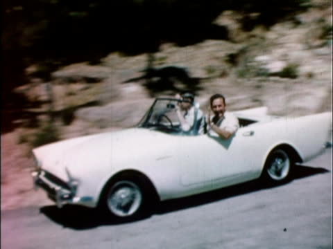 1959 ws pan white 1959 sunbeam alpine driving along winding road / united kingdom - classic car stock videos and b-roll footage