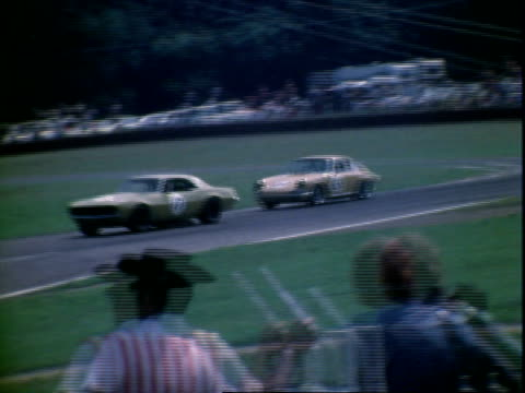 white 1971 ford mustang v8 pace car parked and then driving off leading pack for over 2000 cc transam auto race at midohio sports car course /... - polka dot stock videos and b-roll footage