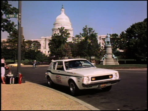 ws 1973 white amc gremlin parked across the street from the us capitol building zi to cu of clean air economy run logo on gremlin's door amc gremlin... - 1973 stock videos & royalty-free footage