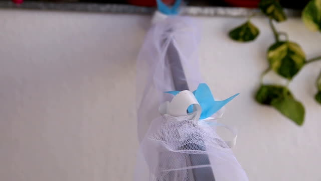 white and blue silk ribbon with bow - ornate stock videos & royalty-free footage