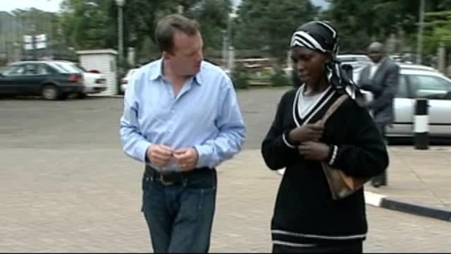 vídeos de stock, filmes e b-roll de white aristocrat on trial for murder of black poacher; ext reporter along with widow of victim serah njoya interview sot - widow