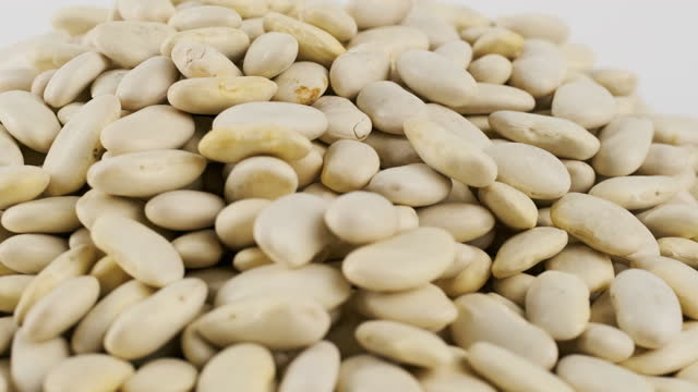 white beans turning on platform white background - dried food stock videos & royalty-free footage