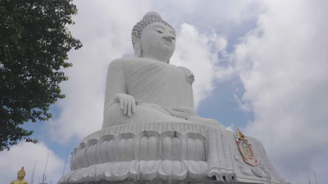 white big buhhda statue on peak mountain of phuket thailand - statuetta video stock e b–roll