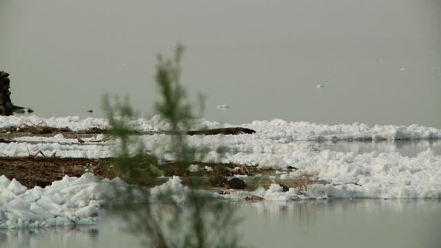 White block of foam on the water