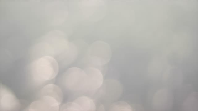 white bokeh background with ray - smooth stock videos & royalty-free footage