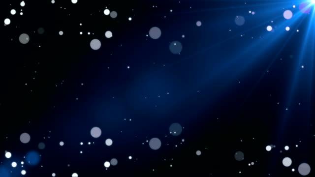 Witte bokeh deeltjes blauwe achtergrond - naadloze Loop Stock Footage Video