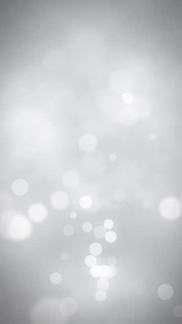 white bokeh seamless loop vertical video background with copy space - vignette stock videos & royalty-free footage