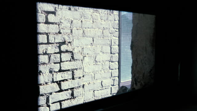 white brick wall - view from window - nyc 2021 - tights stock videos & royalty-free footage