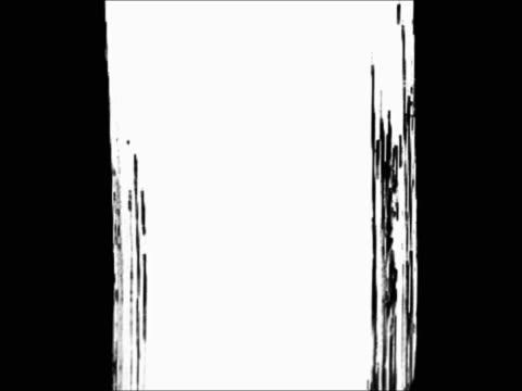 White brush stroke making vertical line over black background