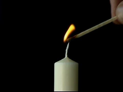 white candle - okänt kön bildbanksvideor och videomaterial från bakom kulisserna