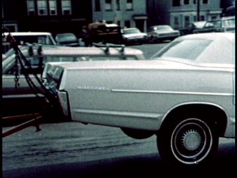 1967 pan white car being towed into garage / usa - tow truck stock videos and b-roll footage