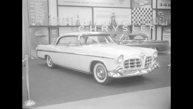 stockvideo's en b-roll-footage met ws white chrysler imperial car with another car behind it form part of the chrysler exhibit at the 1956 international automobile show at the new york... - chrysler