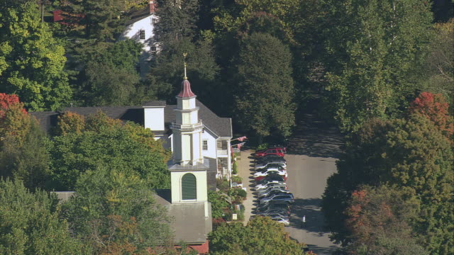 aerial white church with steeple and fall foliage in small town / deerfield, massachusetts, united states - deerfield massachusetts stock videos & royalty-free footage