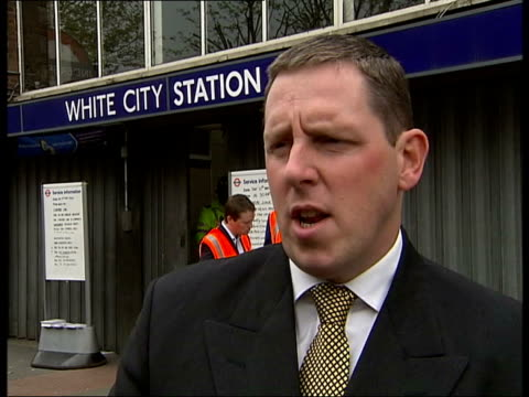 London White City Rail investigator looking at London Underground train that derailed entering White City Station Rail workers and police officers on...