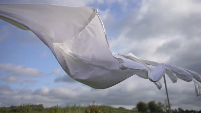 white clean bed sheets blowing in the wind - sheet stock videos & royalty-free footage