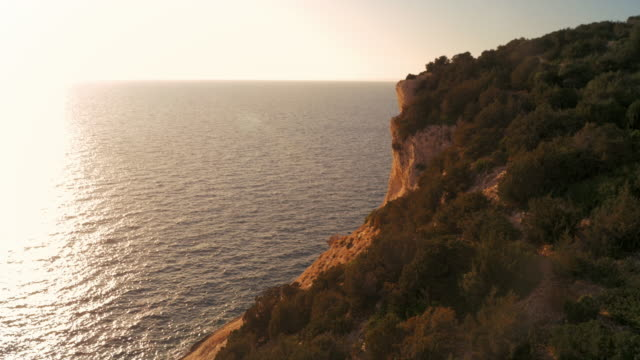 aerial white cliff along the mediterranean sea at sunset - rock face stock videos and b-roll footage