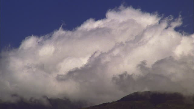 White cloud billows over hills, Maui Available in HD.