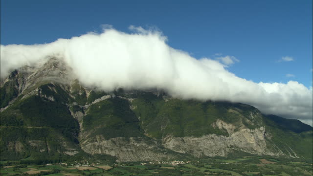 AERIAL WS White cloud floating above mountain in Maritime Alpes / Rhone-Alpes, France