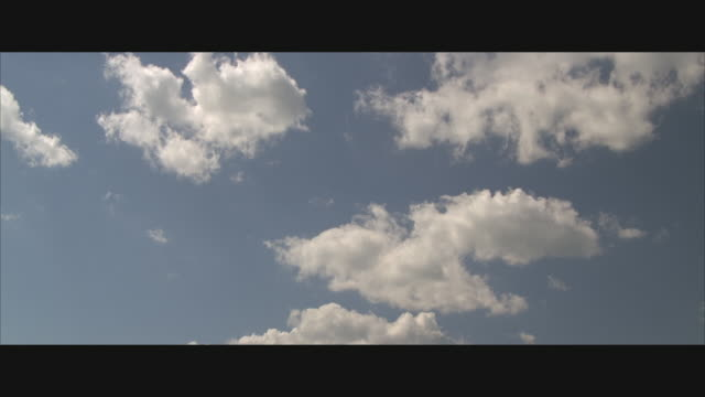 ws, white clouds against blue sky - anamorphic stock videos and b-roll footage