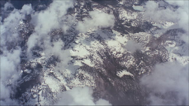 white clouds float above the snowy sierra nevada mountains. - californian sierra nevada stock videos & royalty-free footage