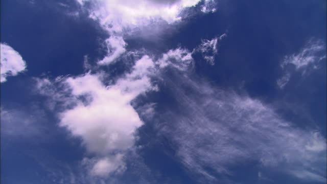 white clouds float across the sky. - rauchartig stock-videos und b-roll-filmmaterial