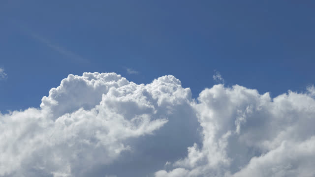 white clouds in a blue sky (time lapse) - cloud sky stock videos & royalty-free footage