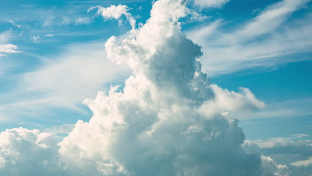 white clouds in a blue sky (time lapse) - cumulonimbus stock videos & royalty-free footage