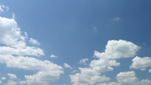 T/L white clouds in blue sky