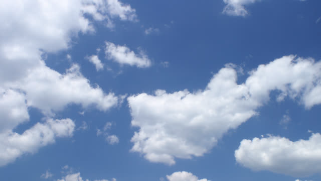 t/l white clouds in blue sky - sky stock videos & royalty-free footage