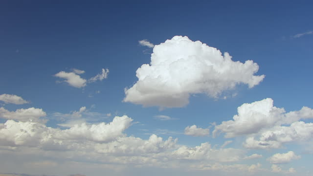 WS AERIAL TU White clouds in sky to landscape in Big Bend Country in Chihuahuan Desert / Texas, United States