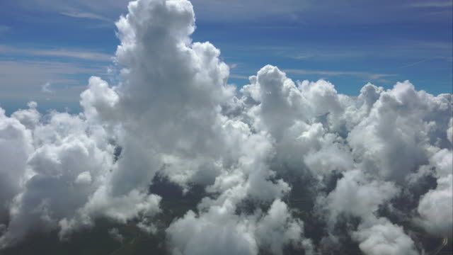 ws aerial pov white clouds moving in blue sky with landscape - stratocumulus stock videos and b-roll footage