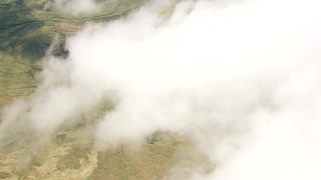 WS AERIAL White clouds moving over large landscape / Kenya