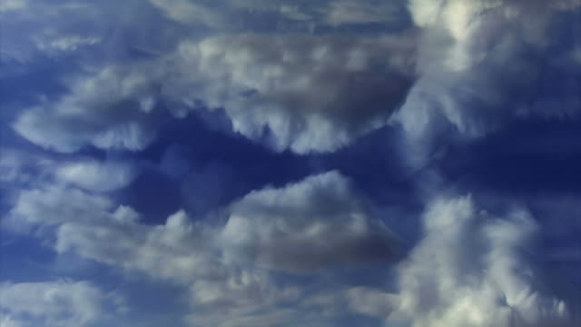 white clouds puff and groove in a blue sky. - digital enhancement stock videos & royalty-free footage