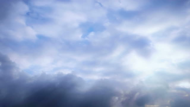 white clouds roil across a blue sky (loop). - sky only stock videos & royalty-free footage
