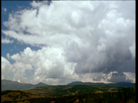 white clouds roll over aberdare range, kenya - roll over stock videos and b-roll footage