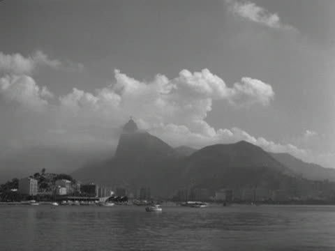 stockvideo's en b-roll-footage met white clouds surround the sugar loaf mountain 1961 - omgeven