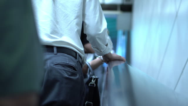 white collar worker man is using escalator - escalator stock videos & royalty-free footage