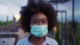 White collar worker woman wearing a mask