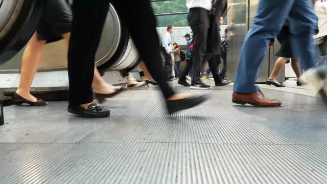 white collar workers commuting to the offices - stazione della metropolitana video stock e b–roll