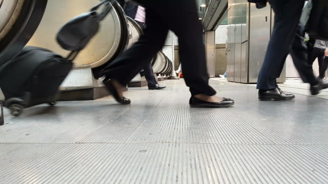 white collar workers commuting to the offices - escalator stock videos & royalty-free footage