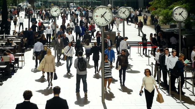 white collar workers in london canary wharf - midday stock videos & royalty-free footage