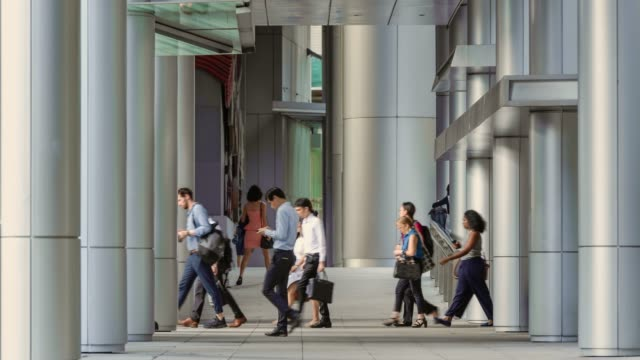 white collar workers on their way to the office, during morning rush hour, in singapore's financial district - beliebiger ort stock-videos und b-roll-filmmaterial