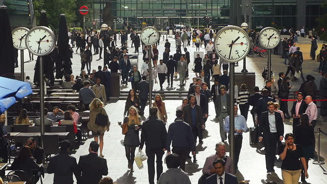 white collar workers walking in london canary wharf - midday stock videos & royalty-free footage