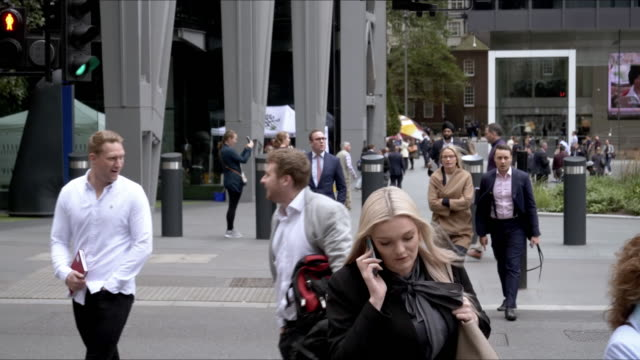 white collar workers walking in the city of london - traffic time lapse stock videos & royalty-free footage