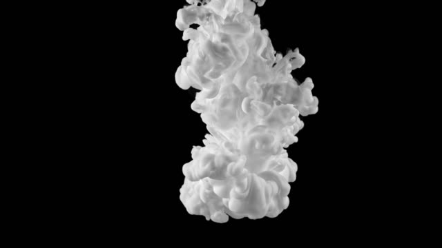 SLO MO White color forming underwater clouds on black background