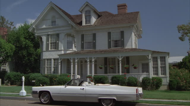 MS, White convertible Cadillac parked in front of residential house