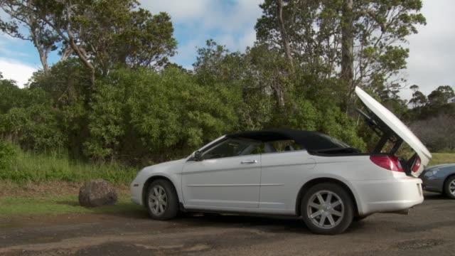 MS White convertible opening top, Kauai, Hawaii, USA