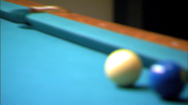 white cue ball rolling on pool table striking solid 2 blue ball sinking blue ball into corner pocket cue sports cuesports - cue ball stock videos & royalty-free footage
