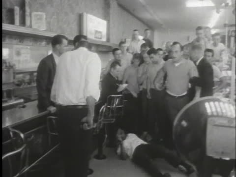 white customer attacks a black student attempting a sit-in at a lunch counter. - lunch stock videos & royalty-free footage